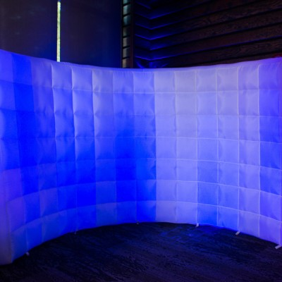 An inflatable backdrop with blue lighting