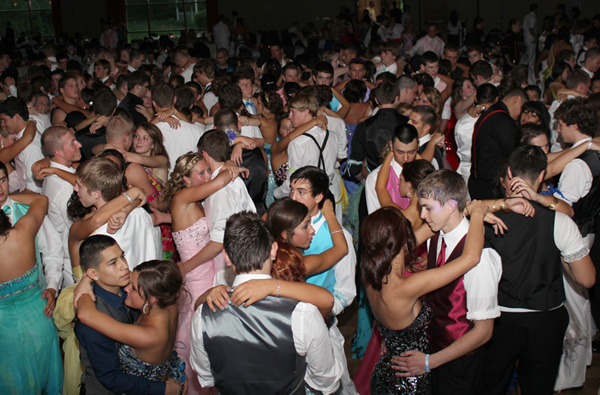 Students dance at a school dance